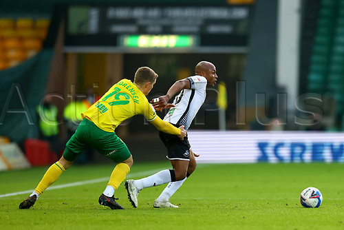 7th November 2020; Carrow Road, Norwich, Norfolk, England, English Football League Championship Football, Norwich versus Swansea City; André Ayew of Swansea City takes on Jacob Lungi Sorensen of Norwich City