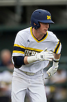 Michigan Wolverines third baseman Jacob Cronenworth (2) runs to first base during the NCAA baseball game against the Washington Huskies on February 16, 2014 at Bobcat Ballpark in San Marcos, Texas. The game went eight innings, before travel curfew ended the contest in a 7-7 tie. (Andrew Woolley/Four Seam Images)