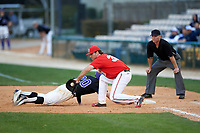 Ohio State Buckeyes first baseman Zach Ratcliff (32) stretches for a throw as Julian Gallup (20) dives back safely with umpire Greg Howard watching the play during a game against the Niagara University Purple Eagles on February 20, 2016 at Holman Stadium at Historic Dodgertown in Vero Beach, Florida.  Ohio State defeated Niagara 10-7.  (Mike Janes/Four Seam Images)