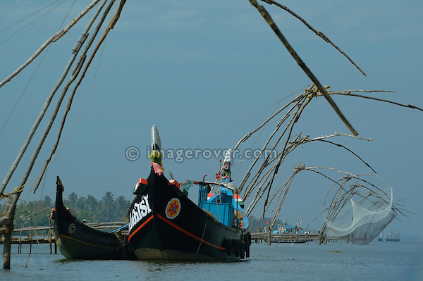 India, Kerala, Backwaters. Row of chinese style fishing nets in the Backwaters between Kollam to Allepey. No releases available.