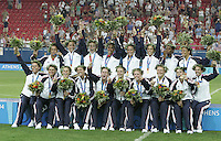 26 August 2004: USA Team with their gold medals after winning the game against Brazil, 2-1 in overtime at Karaiskakis Stadium in Athens, Greece.   Credit: Michael Pimentel / ISI.