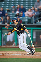 Dustin Garneau (14) of the Salt Lake Bees bats against the Sacramento River Cats at Smith's Ballpark on April 12, 2019 in Salt Lake City, Utah. The River Cats defeated the Bees 4-2. (Stephen Smith/Four Seam Images)