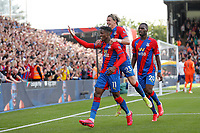 11th September 2021; Selhurst Park, Crystal Palace, London, England;  Premier League football, Crystal Palace versus Tottenham Hotspur: Wilfried Zaha of Crystal Palace celebrates after scoring his goal from a penalty in the 76th minute to make it 1-0 with Conor Gallagher and Christian Benteke of Crystal Palace