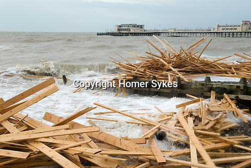 """The beach at Worthing West Sussex England. Planks of wood from the freighter the """"Ice Prince"""" which sank in rough weather on January 15th"""