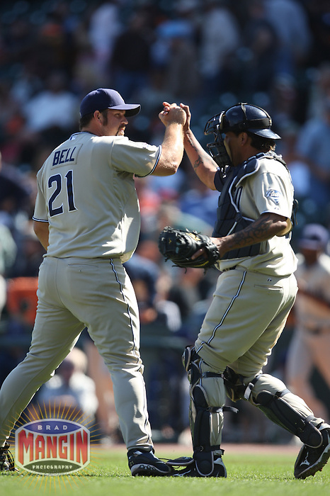 SAN FRANCISCO - SEPTEMBER 9:  Heath Bell #21 and Henry Blanco #28 of the San Diego Padres celebrate after the final out against the San Francisco Giants during the game at AT&T Park on September 9, 2009 in San Francisco, California. Photo by Brad Mangin