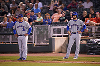 South Bend Cubs coach Ricardo Medina (30) and Matt Rose (5) during a game against the Dayton Dragons on May 11, 2016 at Fifth Third Field in Dayton, Ohio.  South Bend defeated Dayton 2-0.  (Mike Janes/Four Seam Images)