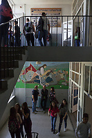 """Serbia. Vranje is a city and the administrative center of the Pčinja District in southern Serbia. «Jovan Jovanović Zmaj» Elementary School. Students and teachers on hallway and stairs. On the bottom floor, the wall painting is about the Battle of Kosovo and the defeat of the Serbian army. The Battle of Kosovo took place on 15 June 1389 between an army led by the Serbian Prince Lazar Hrebeljanović and an invading army of the Ottoman Empire under the command of Sultan Murad Hüdavendigâr. The battle was fought on the Kosovo field  (Kosovo Polje), distant 10 kilometers northwest of Pristina. On the top floor, the portrait pictures of the students. The Pestalozzi Children's Foundation (Stiftung Kinderdorf Pestalozzi) is advocating access to high quality education for underprivileged children. It supports in Vranje a project called"""" Education for child rights"""".17.4.2018 © 2018 Didier Ruef for the Pestalozzi Children's Foundation"""