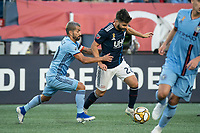 FOXBOROUGH, MA - SEPTEMBER 29: Maximiliano Moralez #10 of New York City FC pressures Carles Gil #22 of New England Revolution during a game between New York City FC and New England Revolution at Gillettes Stadium on September 29, 2019 in Foxborough, Massachusetts.