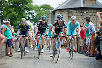 Richie Porte (AUS/SKY) sets the pace for the peloton up the Citadel de Namur cobbles<br /> <br /> stage 4: Seraing (BEL) - Cambrai (FR) <br /> 2015 Tour de France