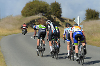 Archie Martin looks back at the chasing peloton during the Under-19 Men's road race, Carterton-Martinborough-Gladstone circuit. Day three of the 2018 NZ Age Group Road Cycling Championships in Carterton, New Zealand on Sunday, 22 April 2018. Photo: Dave Lintott / lintottphoto.co.nz