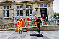Pictured: Captain Beany dances next to a busker in Cardiff, Wales, UK.<br /> Re: Cardiff West independent candidate, Captain Beany where the current elected AM is First Minister for Wales Mark Drakeford, has been canvassing in Cardiff, Wales, UK.<br /> If elected, my first priority shall be renaming the Wales Parliament to that of 'Superhero Space Centre Of Excellence' and I shall dismiss all the existing serving MSs and replace them all with our League of Superheroes' to take up various positions in relation to their superhero powers within the next five years and to advocate an annual 'National Superhero Day' on behalf of the nation at the Principality Stadium in Cardiff for a national registered charity.