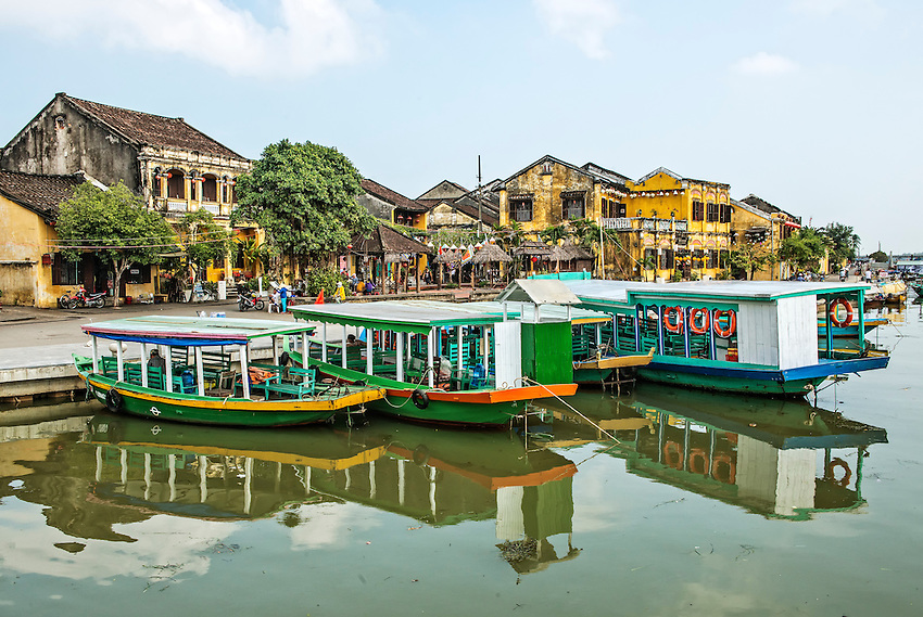 The waterfront at Hoi An, Vietnam, is usually festooned with colorful riverboats ready to provide tours of the city and countryside for tourists.