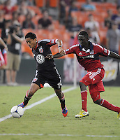 D.C. United defender Andy Najar (14) shields the ball from Chicago Fire midfielder Patrick Nyarko (14) D.C. United defeated The Chicago Fire 4-2 at RFK Stadium, Wednesday August 22, 2012.
