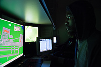 Air Traffic Control Student J.P. Prince role plays as inbound aircraft for other students participating in a simulated scenario in the adjoining Tower Simulator in UAA Aviation Technology Center.