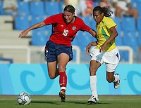 14 August 2004:  Abby Wambach dribbles the ball away from Brazil defender at Kaftanzoglio Stadium in Thessaloniki, Greece.  USA defeated Brazil at 2-0 . Credit: Michael Pimentel / ISI