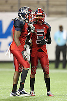 Miramar Patriots defensive back Tracy Howard #3 talks with Malcolm Lewis #1 before a kickoff during the second quarter of the Florida High School Athletic Association 8A Championship Game at Florida's Citrus Bowl on December 17, 2011 in Orlando, Florida.  Plant defeated Miramar 31-20.  (Mike Janes/Four Seam Images via AP Images)