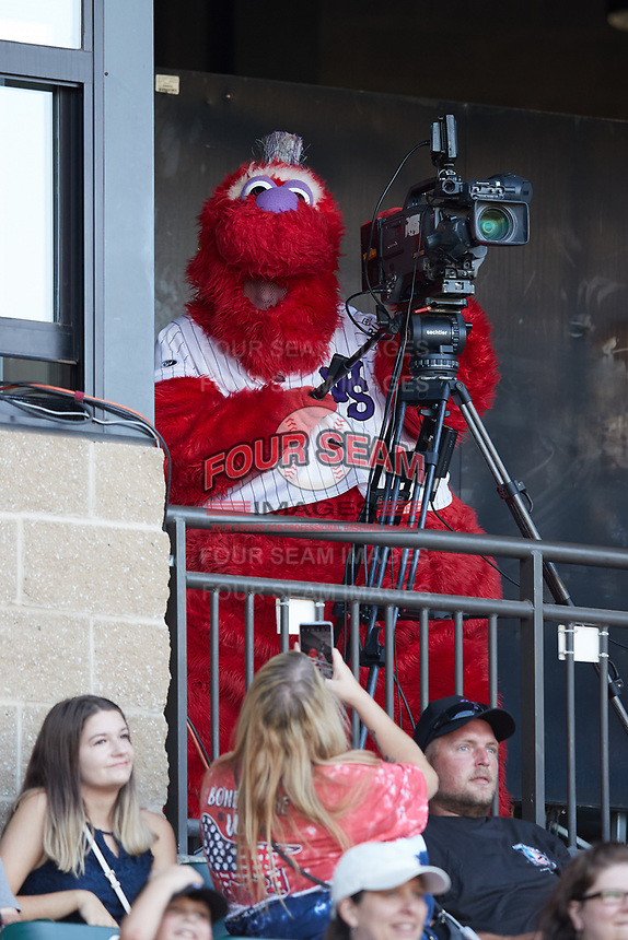 Winston-Salem Dash mascot Bolt plays with a video camera between innings of the game against the Hudson Valley Renegades at Truist Stadium on August 28, 2021 in Winston-Salem, North Carolina. (Brian Westerholt/Four Seam Images)