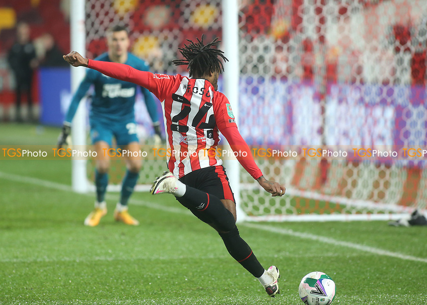 Tariqe Fosu of Brentford crosses the ball into the Newcastle penalty area during Brentford vs Newcastle United, Carabao Cup Football at the Brentford Community Stadium on 22nd December 2020