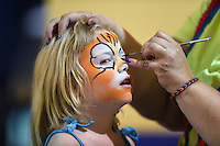 Lakeland Flying Tigers young fan gets her face painted during a game against the Tampa Yankees on April 5, 2014 at Joker Marchant Stadium in Lakeland, Florida.  Lakeland defeated Tampa 3-0.  (Mike Janes/Four Seam Images)