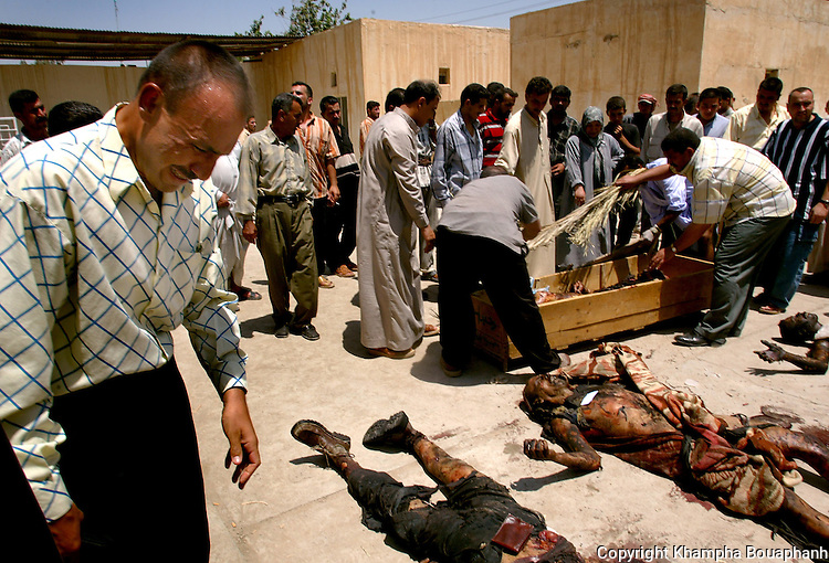An Iraqi man grieves at the morgue in Baqubah, Iraq on July 28, 2004.  Over 50 people were killed and over 50 more were injured when a  bomb detonated near a police recruiting center.  (photo by Khampha Bouaphanh)