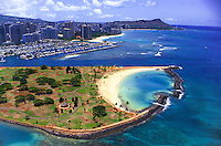 Aerial view of Magic Island with the Ala Wai Yacht Harbor and Diamond Head beyond, O'ahu.