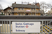 Subway to Swiss Cottage underground station and the Swiss Cottage pub, London.