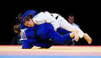 04 DEC 2011 - LONDON, GBR - Maria Portela (BRA) (in white, on top) battles with Karine Berger (FRA) (in blue, on bottom) during the London International Judo Invitational and 2012 Olympic Games test event at the ExCel Exhibition Centre in London, Great Britain .(PHOTO (C) NIGEL FARROW)