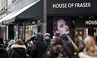Crowds along Oxford Street pass by House of Fraser with icicles hanging as the Beast from the East weather continues at City of London, London, England on 1 March 2018. Photo by Andy Rowland.