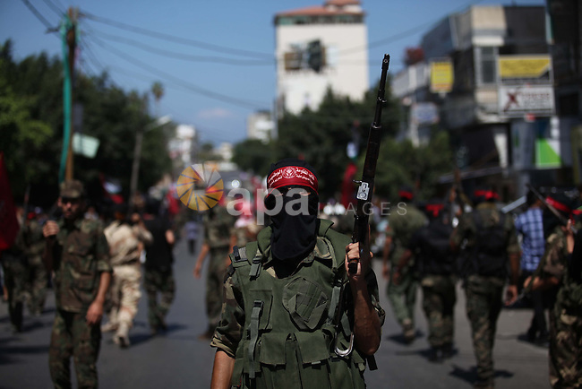 Palestinian militants from the Democratic Front for the Liberation of Palestine (DFLP) take part in a military show in Gaza City September 11, 2014. An open-ended ceasefire between Israel and Hamas-led Gaza militants, mediated by Egypt, took effect on August 26, 2014 after a seven-week conflict. It called for an indefinite halt to hostilities, the immediate opening of Gaza's blockaded crossings with Israel and Egypt, and a widening of the territory's fishing zone in the Mediterranean. Photo by Ashraf Amra