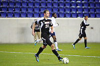 Austin Berry (24) of the Louisville Cardinals. Connecticut defeated Louisville 1-0 during the first semifinal match of the Big East Men's Soccer Championships at Red Bull Arena in Harrison, NJ, on November 11, 2011.
