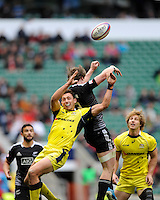 Sam Myers of Australia and Sam Dickson of New Zealand juggle the re-start ball during Day Two of the iRB Marriott London Sevens at Twickenham on Sunday 11th May 2014 (Photo by Rob Munro)