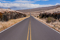 Pi'ilani Highway cutting through the dry, barren south side of Maui