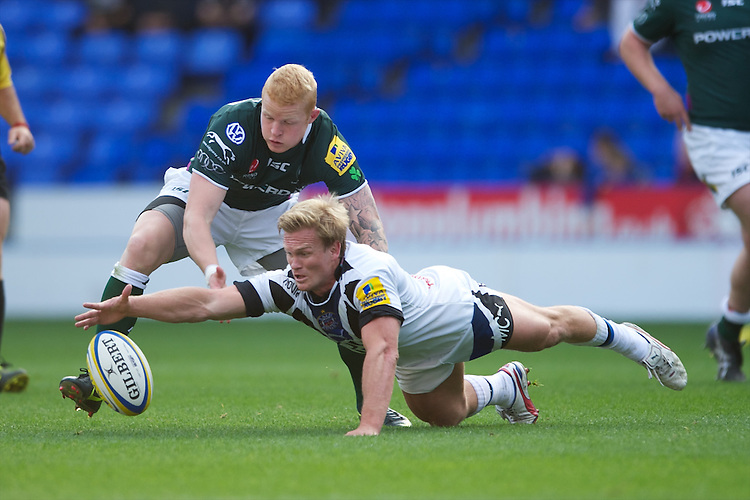 Michael Claassens of Bath Rugby fumbles the loose ball with Tom Homer of London Irish during the Aviva Premiership match between London Irish and Bath Rugby at the Madejski Stadium on Saturday 22nd September 2012 (Photo by Rob Munro)