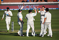 The Black Caps congratulate bowler Tim Southee on his dismissal of Jermaine Blackwood for 69 during day two of the second International Test Cricket match between the New Zealand Black Caps and West Indies at the Basin Reserve in Wellington, New Zealand on Friday, 11 December 2020. Photo: Dave Lintott / lintottphoto.co.nz