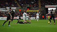 Wednesday, 01 January 2014<br /> Pictured: Angel Rangel of Swansea (C) is tackled by Samir Nasri of Manchester City.<br /> Re: Barclay's Premier League, Swansea City FC v Manchester City at the Liberty Stadium, south Wales.