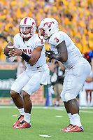 SMU quarterback Matt Davis (4) looks to hand off to running back Kevin Pope (3)  during first half of NCAA inaugural Football game at newly constructed McLean Stadium, Sunday, August 31, 2014 in Waco, Tex. Baylor leads SMU 31-0 in the first half. (Mo Khursheed/TFV Media via AP Images)