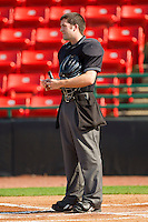 Home plate umpire Andy Draper prior to the start of the South Atlantic League game between the Charleston RiverDogs and the Hickory Crawdads at L.P. Frans Stadium on April 29, 2012 in Hickory, North Carolina.  The Crawdads defeated the RiverDogs 12-3.  (Brian Westerholt/Four Seam Images)