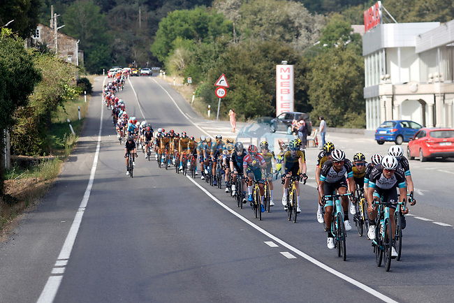 The peloton led by Team BikeExchange during Stage 19 of La Vuelta d'Espana 2021, running 191.2km from Tapia de Casariego to Monforte de Lemos, Spain. 3rd September 2021.    <br /> Picture: Luis Angel Gomez/Photogomezsport | Cyclefile<br /> <br /> All photos usage must carry mandatory copyright credit (© Cyclefile | Luis Angel Gomez/Photogomezsport)