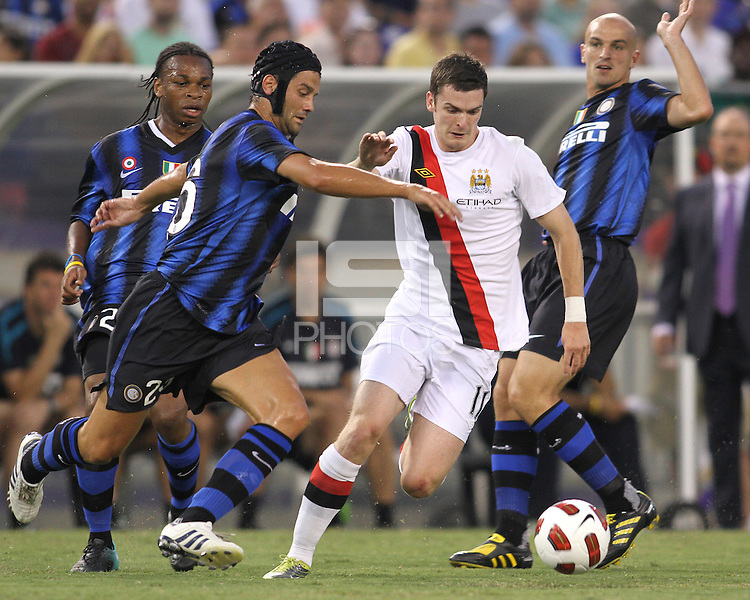 Christian Chivu #26 of Inter Milan goes for the ball with Adam Johnson #11 of Manchester City during an international friendly match on July 31 2010 at M&T Bank Stadium in Baltimore, Maryland. Milan won 3-0.