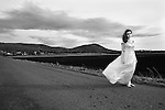 A barefoot teenage bride on a desolate road in farmland