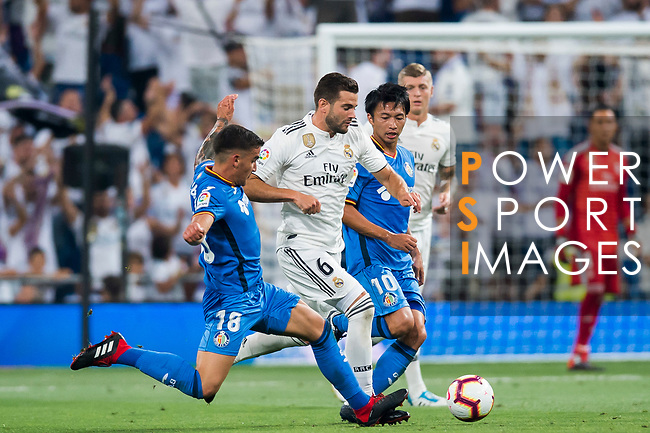 Nacho Fernandez (C) of Real Madrid competes for the ball with Mauro Wilney Arambarri Rosa (L) and Gaku Shibasaki of Getafe CF  during the La Liga 2018-19 match between Real Madrid and Getafe CF at Estadio Santiago Bernabeu on August 19 2018 in Madrid, Spain. Photo by Diego Souto / Power Sport Images