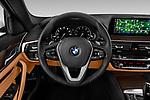 Car pictures of steering wheel view of a 2019 BMW 5-Series 530I-Sport-Line 4 Door Sedan Steering Wheel