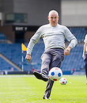 Mark Warburton taking a penalty kick past Robby McCrorie in goals