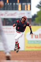 Batavia Muckdogs third baseman J.C. Millan (4) runs to third base on a triple in the bottom of the first inning during a game against the Lowell Spinners on July 12, 2017 at Dwyer Stadium in Batavia, New York.  Batavia defeated Lowell 7-2.  (Mike Janes/Four Seam Images)