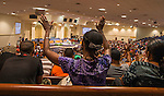 BATON ROUGE, LA -JULY 07:  Close to 1200 people pray during a prayer vigil for Alton Sterling at the Living Faith Christian Center in Baton Rouge, Louisiana July 7, 2016.  Sterling was shot and killed by police on July 5, 2016 in Baton Rouge, Louisiana. (Photo by Mark Wallheiser/Getty Images)