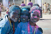 Three sisters covered with color dye, The Color Run 2015, Tacoma, Washington State, WA, America, USA.