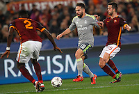Calcio, andata degli ottavi di finale di Champions League: Roma vs Real Madrid. Roma, stadio Olimpico, 17 febbraio 2016.<br /> Real Madrid's Dani Carvajal, center, is challenged by Roma's Antonio Ruediger, left, and Miralem Pjanic during the first leg round of 16 Champions League football match between Roma and Real Madrid, at Rome's Olympic stadium, 17 February 2016.<br /> UPDATE IMAGES PRESS/Riccardo De Luca