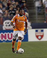 Houston Dynamo defender Jermaine Taylor (4) brings the ball forward. In a Major League Soccer (MLS) match, the New England Revolution tied Houston Dynamo, 2-2, at Gillette Stadium on May 19, 2012.