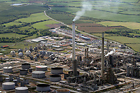 Pictured: Aerial view of the Chevron oil refinery in Rhoscrowther near Pemroke Dock, Pembrokeshire, west Wales. Monday 06 June 2011.<br /> Re: The four people killed in the explosion and fire at the Chevron oil refinery in Pembrokeshire have been named.<br /> They were Julie Jones, 54, a fire guard from Pembroke, and three men from Milford Haven: Dennis Riley, 52, Robert Broome, 48, and Andrew Jenkins, 33.<br /> Ms Jones was a mother of one and grandmother, Mr Riley a father of two and grandfather, Mr Broome a father of seven and Mr Jenkins had young twins.<br /> A fifth person is critical but stable after Thursday's blast at Pembroke.<br /> Churches are opening their doors to allow people to say prayers for the victims, with books of condolence available and priests offering support.<br /> <br />  <br /> It could be some time before the cause of the explosion is known Dyfed-Powys Police said the bodies were removed from the scene on Friday night.