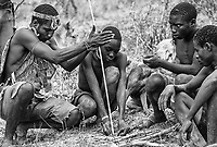 One of the more unique experiences on this trip involved joining a nomadic Hadzabe (Hadza) tribe. Here, they work on starting a fire.